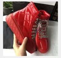 pair of red leather high-top sneakers 54 km