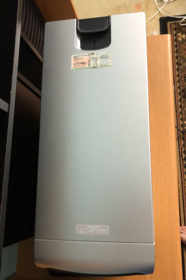 Dell desktop with keyboard, mouse, speakers, monitor a6883178-2988-4f67-aca3-43254a572f0e