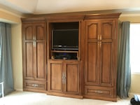 Brown wooden tv hutch with flat screen television Overland Park, 66212