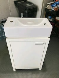 white front-load clothes washer Toronto, M6K 2X3