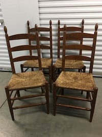 two brown wooden ladder back chairs