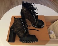 pair of black leather boots Brossard, J4Z 3C2