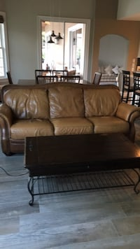leather couch and coffee table negotiable  Winter Garden, 34787
