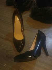 pair of black patent leather pointed heels Calgary, T2K