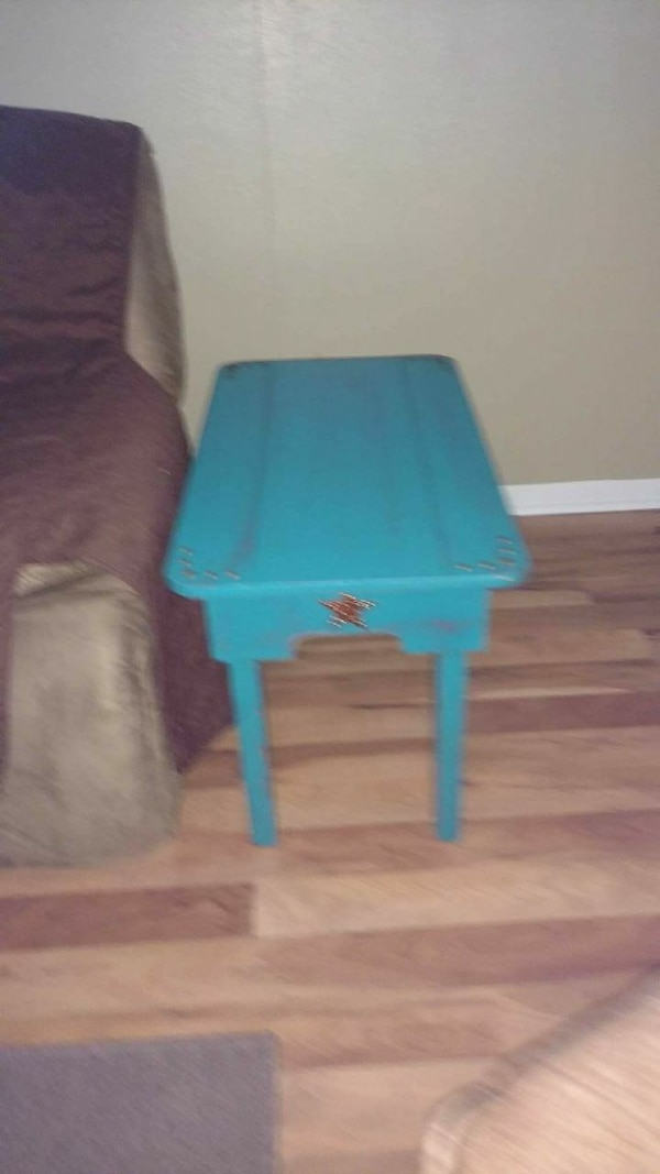 square blue wooden table