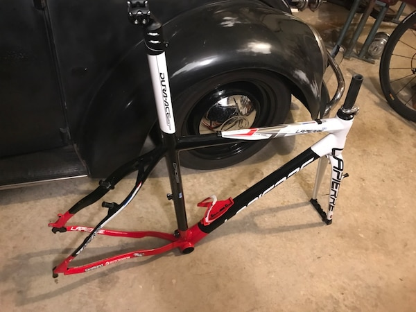 Red and white LaPierre cross frame