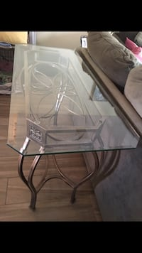 Glass rectangular couch table with dark brass base. Pompano Beach, 33062