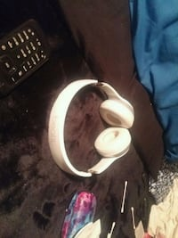 white and black corded headphones