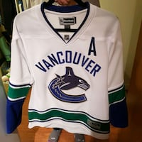 white and blue Vancouver Canucks jersey Richmond