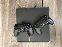Black sony PS4 console with two controllers Fairfax, 22030