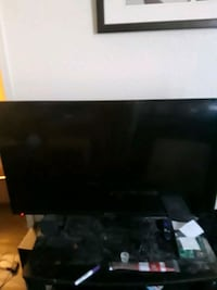 black flat screen TV with remote Tulsa, 74134