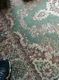 green and white floral area rug