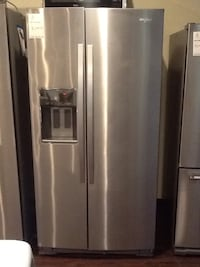 stainless steel whirlpool side-by-side refrigerator with dispenser WRS973CIDM