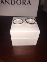 two silver-colored Pandora rings with box