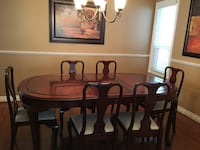 oval brown wooden table with dining set with hutch/buffet North Vancouver, V7G 2P4