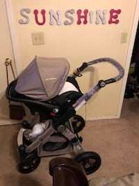 baby's black and gray bassinet stroller