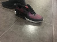 pair of black-and-red Nike running shoes Toronto, M4H 1J5