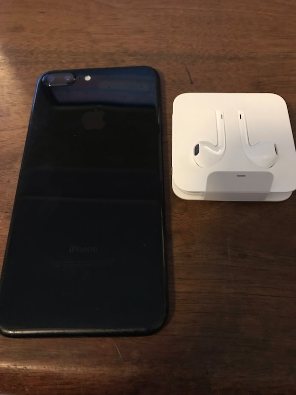 black iPhone 7 with Apple EarPods