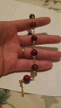 gold-colored and brown beaded bracelet