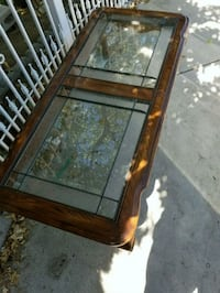 rectangular brown wooden framed glass top coffee table Bakersfield, 93306