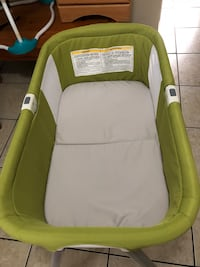 baby's green and white bassinet Miami, 33136