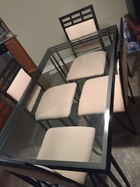 Dining glass table top with four chairs in mint condition PICK UP ONLY Mississauga, L5B 3B2