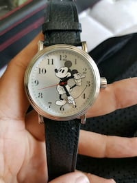 round silver-colored chronograph watch with black leather strap