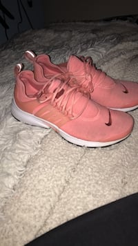 pair of pink Nike running shoes Airdrie, T4B
