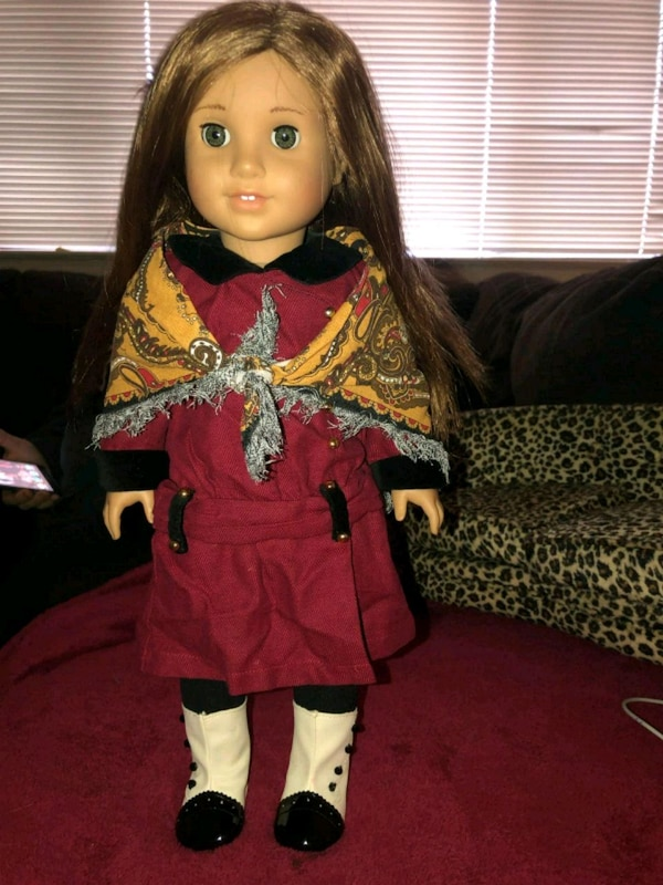 girl in red and black dress doll