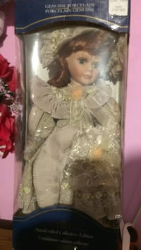 Genuine porcelain doll in sealed package. Brampton, L6T 2T4