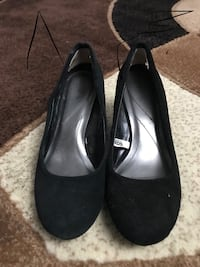 pair of black suede slip-on heeled shoes