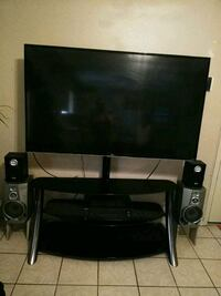 65 inch TV smart Roku tv w stand and surround syst Pharr, 78577