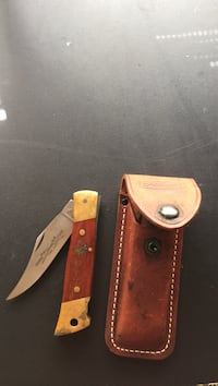 Brown and gray pocket knife with case