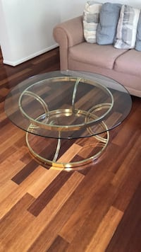 round clear glass-top table with gray steel base Sterling, 20165