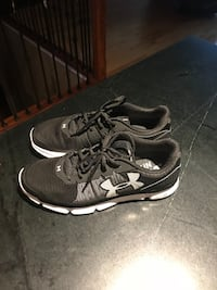 Pair of black-and-gray under armour athletic shoes