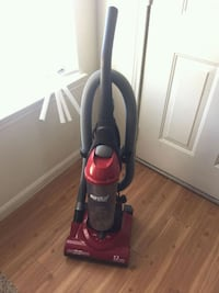 red and black Eureka upright vacuum cleaner College Station, 77840