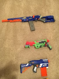 Nerf guns (14) vest, goggles and accessories