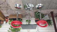 three red and white metal candle holders BOLTON