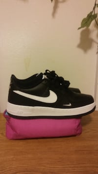 pair of black-and-white Nike Air shoes