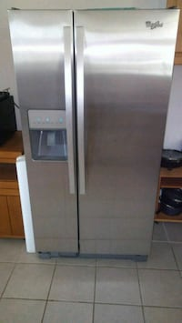 gray side-by-side refrigerator with dispenser Madison, 07940