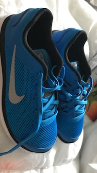 pair of blue Nike running shoes Macomb, 48042