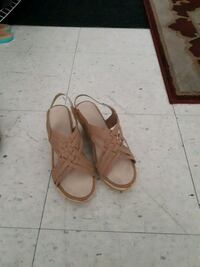 pair of brown leather sandals Toronto, M4H 1L5