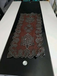 tapis floral noir et marron Paris
