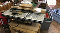 Brown and black table saw