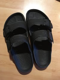Brand new!! Pair of black slide sandals Canmore, T1W 1L2