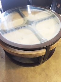 The coffee table comes with four pull out seats. Excellent condition.