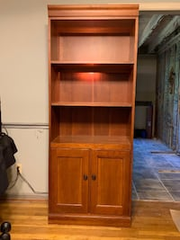 Lighted cherry bookcase by Hooker Kensington