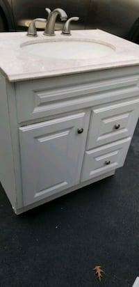 vanity with counter top, faucet  and valves almost new Ashburn