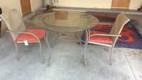 Round clear glass top table with gray metal base Las Cruces, 88011