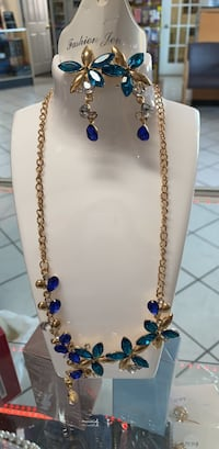 gold-colored necklace with blue gemstones
